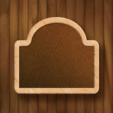 Vector Board Frame on Wood Wall Stock Photography