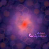 Vector bokeh background. On purple backdrop and red shine in the center Stock Photography