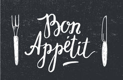 Vector Bon Appetit poster with fork and knife on black textured background. Stock Photos