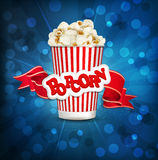 Vector box with popcorn on a blue background Stock Photography