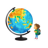 Vector boy with schoolbag looks at big globe Stock Images