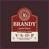 Brandy label template. Vector brandy label isolated on a brown background. Distilling business branding and identity design elements vector illustration