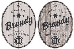 Vector brandy labels. Set of vector brandy labels on the background of wooden boards royalty free illustration