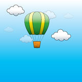 Vector Bright Hot Air Balloon flying in the blue sky Royalty Free Stock Photos