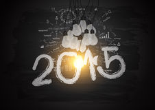 Vector bright light bulb illuminate the number 2015 on blackboard. Bright light bulb illuminate the number 2015 on blackboard, With creative drawing business Stock Images