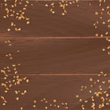 Vector brown background with wooden texture and ground nuts Stock Photo