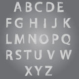 Vector  Brush Style Hand Drawn Alphabet Font. Characters in a pattern drawn on a gray background Stock Images