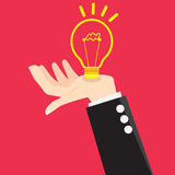 Vector Bulb Light Good Idea in Hand. Hands of a businessman with a light bulb idea Royalty Free Stock Image