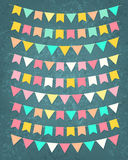 Vector bunting party flags. Set in different colors on grunge background Stock Photos