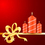 Vector burning Candles of ribbon on the red background Royalty Free Stock Images