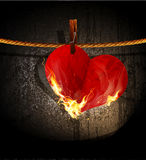 Vector burning heart hanging on a rope Stock Photography