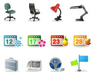 Vector business icons. A collection of business and desktop related icons, including desk lamp, chair, calender dates indicating the seasons, briefcase, clock Stock Image