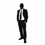 Vector business man black silhouette. Standing full length over white background hold hands in pockets wear suit and tie Stock Photography