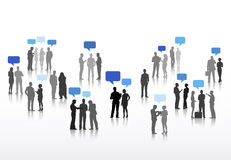 Vector of Business People Discussing with Speech Bubbles Royalty Free Stock Photography