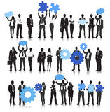 Vector of Business People Holding Gear and Speech Bubble Royalty Free Stock Photography