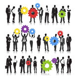 Vector of Business People Holding Gears Stock Photo