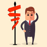 Vector Businessman or manager have to choose between different routes. He is looking on a road sign with directions Royalty Free Stock Photos