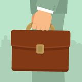 Vector businessman's hand holding briefcase Stock Photography