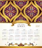 Vector calendar for 2017, floral decor. Vector calendar for 2017. Ornate decorated calendar grid. Golden floral decor, place for company logo and tagline stock illustration