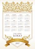 Vector calendar for 2017, golden floral decor. Vector calendar for 2017. Ornate decorated calendar grid. Golden floral decor, place for company logo and tagline Stock Illustration