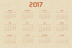 Vector calendar for 2017 in the retro style. Calendar with the image of the constellations on brown circle and beige scratched. Background. Elements for royalty free illustration