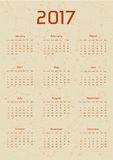 Vector calendar for 2017 in the retro style. Calendar with the image of the constellations on brown circle and beige scratched background. Elements for vector illustration