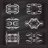 Vector calligraphic design elements. Set of elegant white flourishes for your design on the chalkboard Stock Image