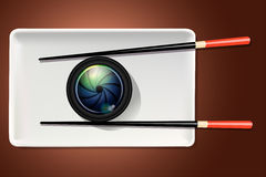 Vector of camera lens on white plate with chopstick. Royalty Free Stock Photo