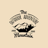 Vector camp logo. Tourism sign with hand drawn mountains landscape. Retro hipster badge, label of outdoor adventures. Royalty Free Stock Photos