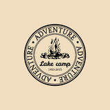 Vector camp logo. Tourist sign with hand drawn image of bonfire. Retro hipster emblem,badge,label of outdoor adventures. Stock Photos