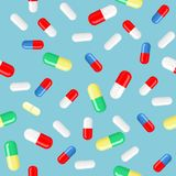 Vector capsules of different colors, shapes and sizes of the individual elements. Seamless background, pattern. Vector pills and capsules in different colors royalty free illustration