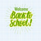 Vector card Back to school lettering. Round icon on a checkered paper background. Children`s design. Back to school lettering. Round icon on a checkered paper Royalty Free Stock Photos