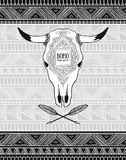 Vector card with crossed ethnic arrows and bull skull on the tribal ornamental background. Royalty Free Stock Images