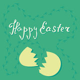 Vector card of easter egg and cracked eggshell on green background with chicken footprints Stock Photos