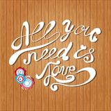 Vector card with hand lettering text All you need is love. Royalty Free Stock Photo