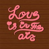 Vector card with hand lettering text All you need is love. Royalty Free Stock Images