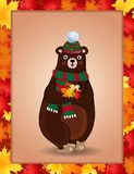 Cute bear in green knitted scarf and hat holding maple leaves in autumn border Vector Illustration