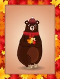 Cute bear in red knitted scarf and hat holding maple leaves in autumn frame Vector Illustration