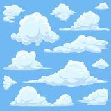 Vector cartoon clouds in blue sky Royalty Free Stock Photography