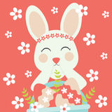 Vector cartoon of cute bunny and a basket of egg on red background Royalty Free Stock Photos