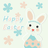 Vector cartoon of cute bunny with blue and pink flowers Stock Images