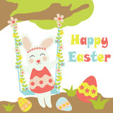 Vector cartoon of cute bunny swings behind tree and colorful egg Stock Images