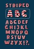Vector cartoon funny Christmas striped candy alphabet letters. Vector cartoon funny Christmas striped candy cane alphabet letters. White and red stirpes on blue Stock Photos