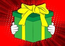 Cartoon hand holding big gift box. royalty free illustration
