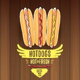 Vector cartoon hotdogs label isolated on wooden table background. Vintage hot dog poster or icon design element Stock Image