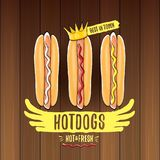 Vector cartoon hotdogs label isolated on wooden table background. Vintage hot dog poster or icon design element Stock Photos