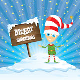 Vector cartoon merry Christmas elf on north pole. Vector cartoon cute merry Christmas elf standing on winter snow landscape near wooden sign board with greeting Royalty Free Stock Images