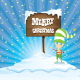 Vector cartoon merry Christmas elf on north pole. Vector cartoon cute merry Christmas elf standing on winter snow landscape near wooden sign board with greeting Royalty Free Stock Photo