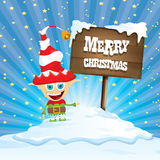 Vector cartoon merry Christmas elf on north pole. Vector cartoon cute merry Christmas elf standing on winter snow landscape near wooden sign board with greeting Stock Photography