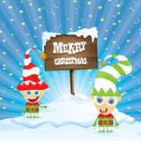 Vector cartoon merry Christmas elf on north pole. Vector cartoon cute merry Christmas elf standing on winter snow landscape near wooden sign board with greeting Royalty Free Stock Image